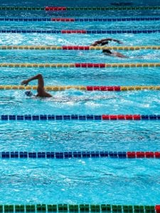 Swimmers racing in an olympic sized pool